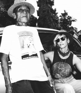 old gentleman with beautiful woman in hat and sunglasses